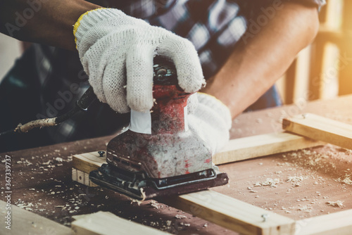 Carpenter working on wood craft at workshop to produce construction material or wooden furniture Canvas