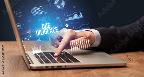 Fotografie, Obraz Businessman working on laptop with DUE DILIGENCE inscription, new business conce