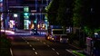 A night timelapse of the urban city street in Aoyama long shot tilt