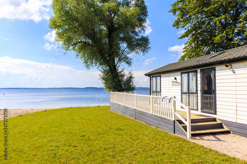 Vászonkép Camping house in sailing port Nowe Guty on Lake Sniardwy on summer sunny day,  M