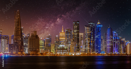Fototapety, obrazy: Doha Qatar skyline at night showing skyscrapers lights reflected in the Arabic gulf