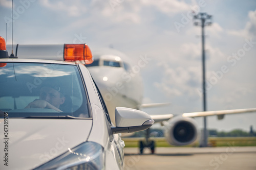 Fototapety, obrazy: Civil airplane following an airport ground vehicle