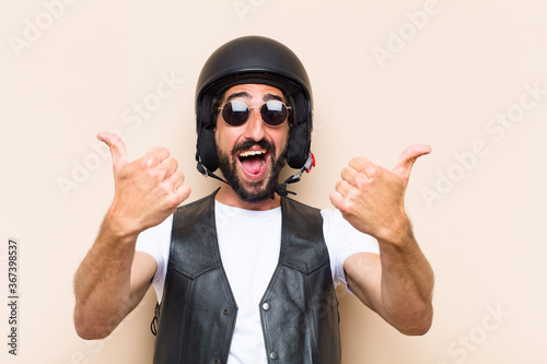 young cool bearded man with a helmet looking successful. motorbi Canvas-taulu