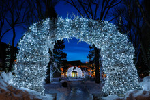 Brightly Lit Elk Antler Arches In Jackson Wyoming Town Square In Winter At Twilight