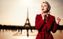 Blonde Girl In Red Coat And Vi...