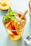 Fototapeta Kawa jest smaczna - Iced tea with peach and ice cubes