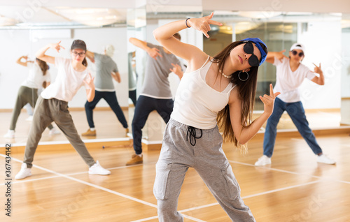Teenagers boy and girls performing hip hop at group dance class Canvas-taulu
