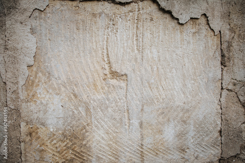 Foto Plaster peeling off brick wall