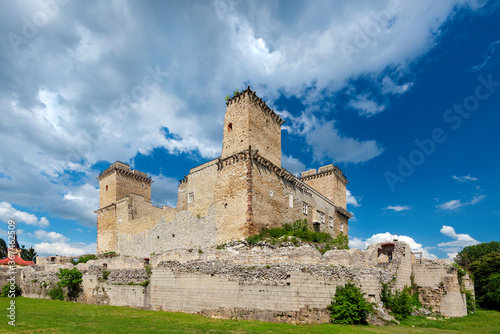 Fototapeta Medieval gothic castle in the historical town of Diosgyor in the Northern Hungarian city Miskolc. View of stone facade in summer in sunny weather with clouds. obraz