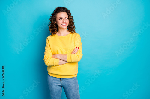 Portrait of her she nice-looking attractive lovely pretty smart clever cheerful cheery wavy-haired girl copy space folded arms isolated on bright vivid shine vibrant blue color background