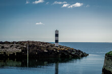 A Lonely Lighthouse Guards The...