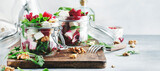 Fototapeta Kawa jest smaczna - Beet salad with arugula, goat cheese and nuts, trendy salad jar, gray kitchen table. Panoramic banner with copy space