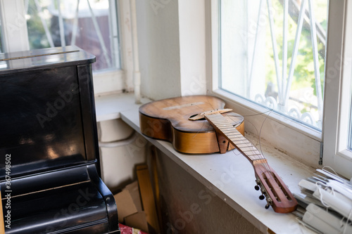 Old dusty guitar in an old house Wallpaper Mural