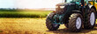 Leinwandbild Motiv agricultural machinery farm equipment - tractor standing on the field. banner copy space