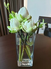 Beautiful Lotus Flower In Grass Vase On The Wooden Table.