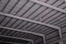 Industrial Warehouse Interior Of Roof Ceiling Structure Skylights With And Pendant Lamps