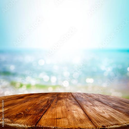Canvastavla Wooden desk of free space and summer ocean landscape