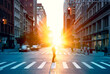 Blurred image of a man walking across the street in New York City with the bright light of sunset shining through the buildings