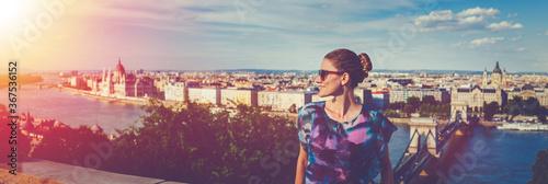Happy young woman wondering in Budapest sunset panorama, Hungary Fototapeta