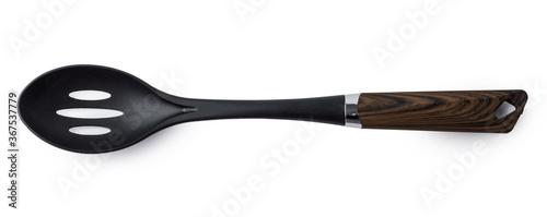 Obraz na plátně Black plastic spoon for draining on white background