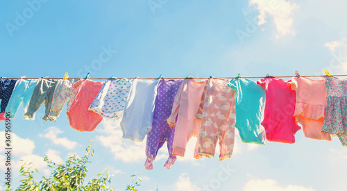 Baby clothes are drying on the street. Selective focus. Canvas Print