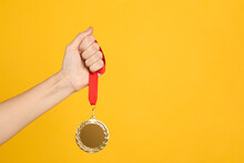 Woman Holding Golden Medal On ...