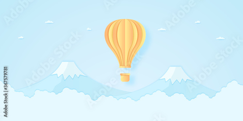 Canvastavla bright hot air balloon flying over mountain with blue sky, paper art style