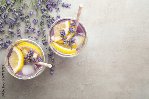Obraz Fresh delicious lemonade with lavender on grey table, flat lay. Space for text - fototapety do salonu