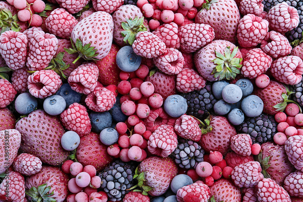 Fototapeta Mix of different frozen berries as background, top view