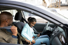 Father Teaching Teen Daughter To Drive Car