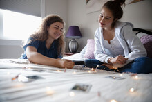 Teenage Girls Making Photograph Clip String Light Decoration