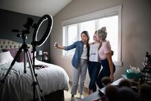 Teenage Girls Vlogging, Taking...