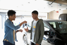 Mother Giving Car Keys To Teen...