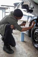 Teen Boy Detailing Car Wheels ...