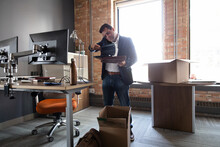 Businessman Unpacking Belongin...