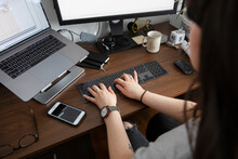 Young Woman Using Wireless Key...