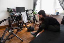 Woman About To Use Turbo Trainer
