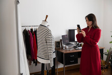 Woman Photographing Clothing In Home Studio