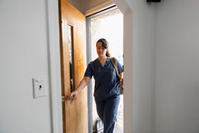 Nurse Arriving Home From Work