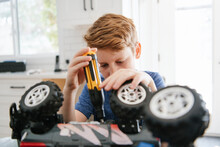 Boy With Screwdriver Fixing Toy Truck