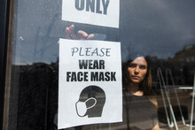Young Woman Putting Face Mask ...
