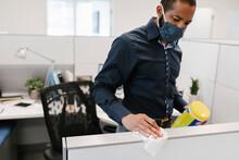 Man Wearing Facemask Sanitizin...