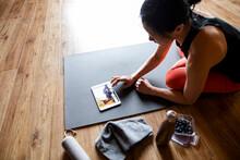 Female Yoga Instructor Using D...