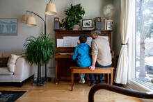 Father And Son Playing Piano T...