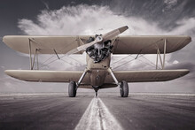 Historical Biplane On A Runway Ready For Take Off