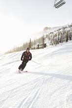 Man Downhill Skiing On Sunny S...