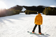 Male Snowboarder On Sunny Snow...