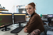Portrait Confident High School Girl Student Using Computers In Classroom