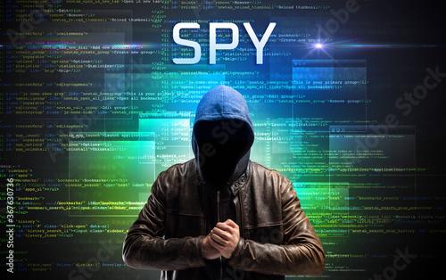 Fototapety, obrazy: Faceless hacker with SPY inscription on a binary code background