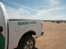 A Border Patrol Truck Parked In The Desert